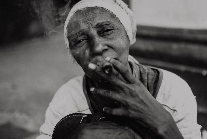 Seeing a lot of people in Cuba smoking cigars is not even a cliche. close-up Woman Smoking blackandwhite portrait person Close-up Woman Smoking Blackandwhite Portrait One Person Adult Real People Lifestyles The Portraitist - 2018 EyeEm Awards