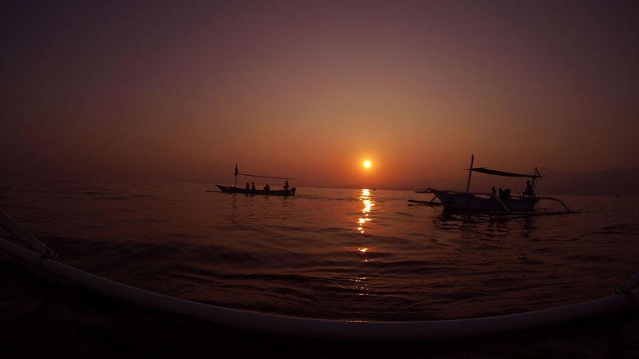 ... Dolphin watching near Lovina beach Atmosphere Bali Bali, Indonesia Beach Boat Dolphin Dolphin Watching  Horizon Over Water Journey Junkung Sea Sun Sunrise Goprohero4