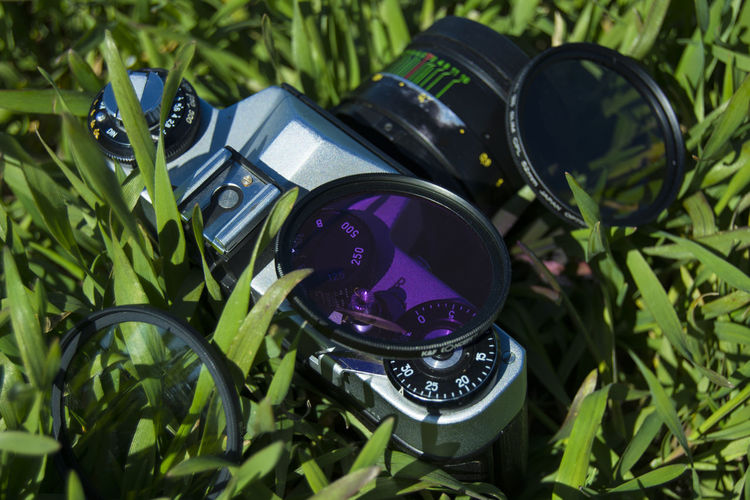 High angle view of camera on grass
