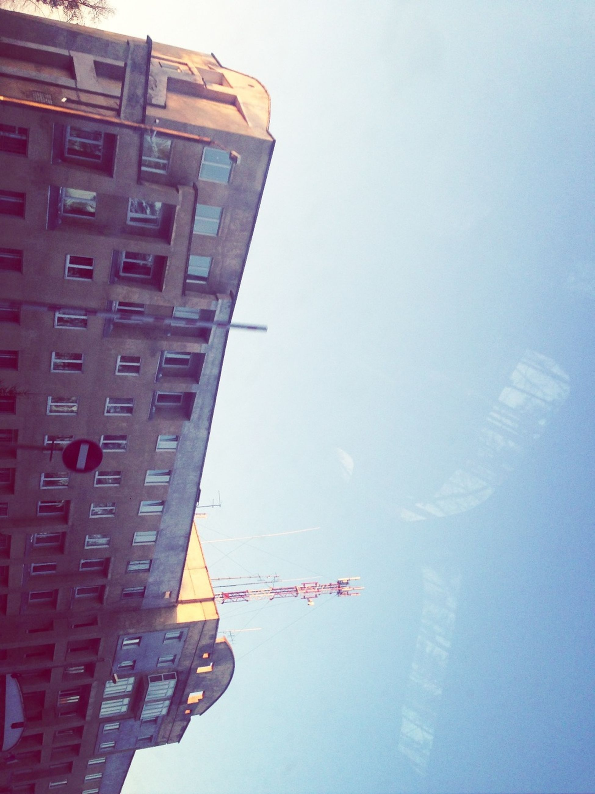 architecture, building exterior, built structure, city, low angle view, sky, tower, building, tall - high, clear sky, skyscraper, modern, office building, travel, reflection, outdoors, transportation, city life, capital cities, travel destinations