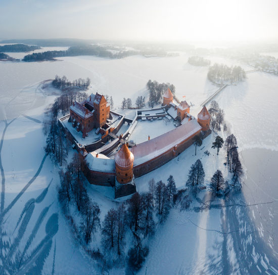 Lake Island Castle in Winter, Trakai, Lithuania Trakai Trakai Castle Trakai Island Castle Lithuania Lietuva Winter Ice Castle Ancient Medieval Island Lake Arctic Cold Temperature Blue Aerial View Panorama View Cold White Background Snow Europe Mansion Fort Fortress