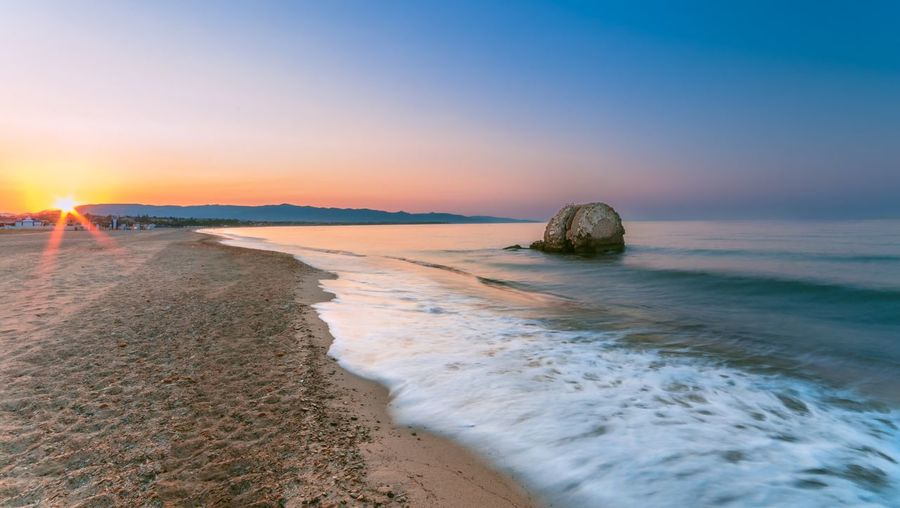 Sea Beach Water Sky Land Sunset Scenics - Nature Tranquility Beauty In Nature Horizon Over Water Tranquil Scene Horizon Nature Sand Idyllic Motion No People Rock Stack Rock