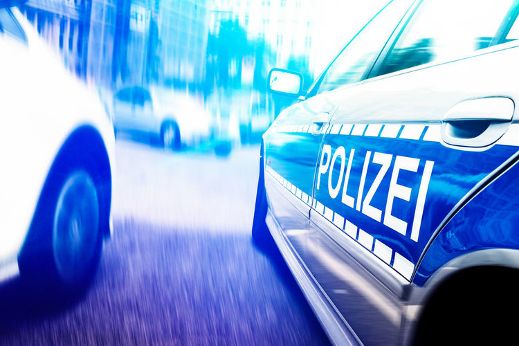 City Blue Car Chase Close-up Emergency Light Germany Illuminated Law Lighting Equipment Mode Of Transportation Motion Motor Vehicle No People Police Car Police Force Speed Tire Wheel