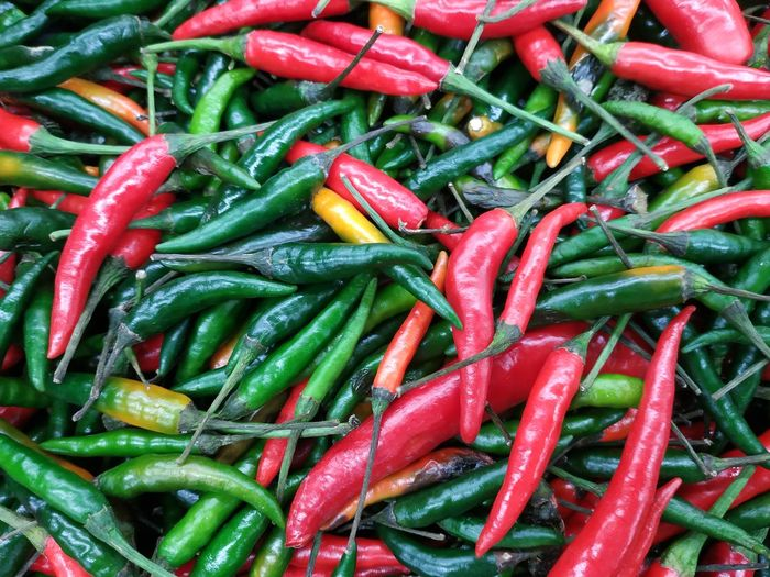 Red & Green Chillies Backgrounds Red Full Frame Vegetable Market Spice For Sale Close-up Food And Drink Green Color Green Chili Pepper Red Chili Pepper Ingredient Market Stall Farmer Market Street Market Display Raw Chili