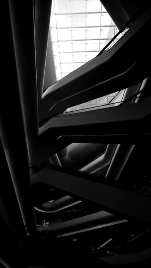 abstract darkness and light Labyrinth Art is Everywhere Shopping Mall Tangled Perspective Labyrinth Abstract Scary Black & White Shopping Mall Escalator Staircase Indoors  Architecture Architectural Detail Interior Blackandwhite Photography Retail  Vertical Blackandwhite The Architect - 2018 EyeEm Awards Close-up Skylight Ceiling Architectural Design Building Interior Roof Beam Architectural Feature Architecture And Art Stairs Steps And Staircases