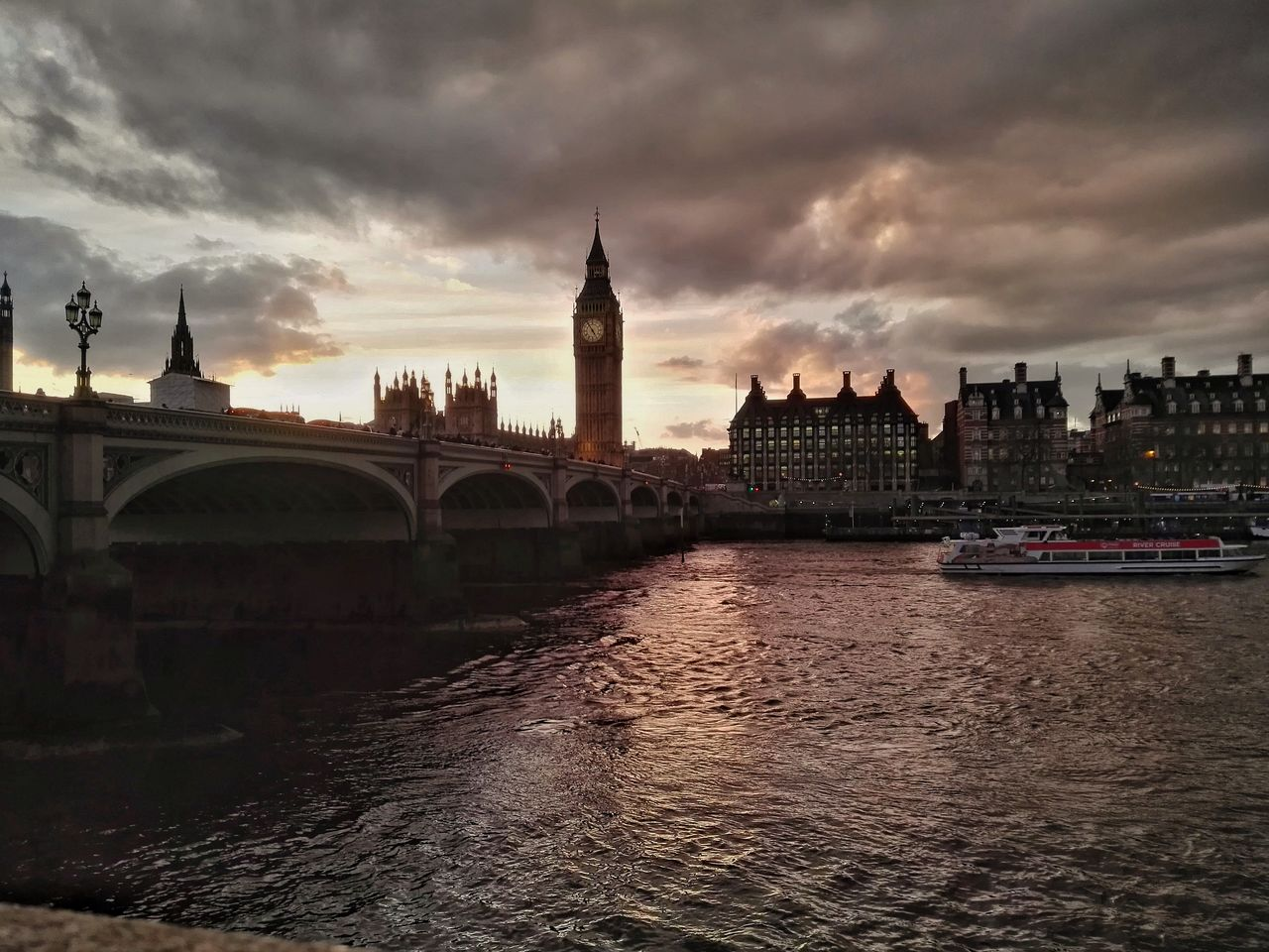 architecture, built structure, cloud - sky, building exterior, river, sky, water, waterfront, city, sunset, travel destinations, bridge - man made structure, clock tower, outdoors, no people, cityscape, day, nautical vessel, nature