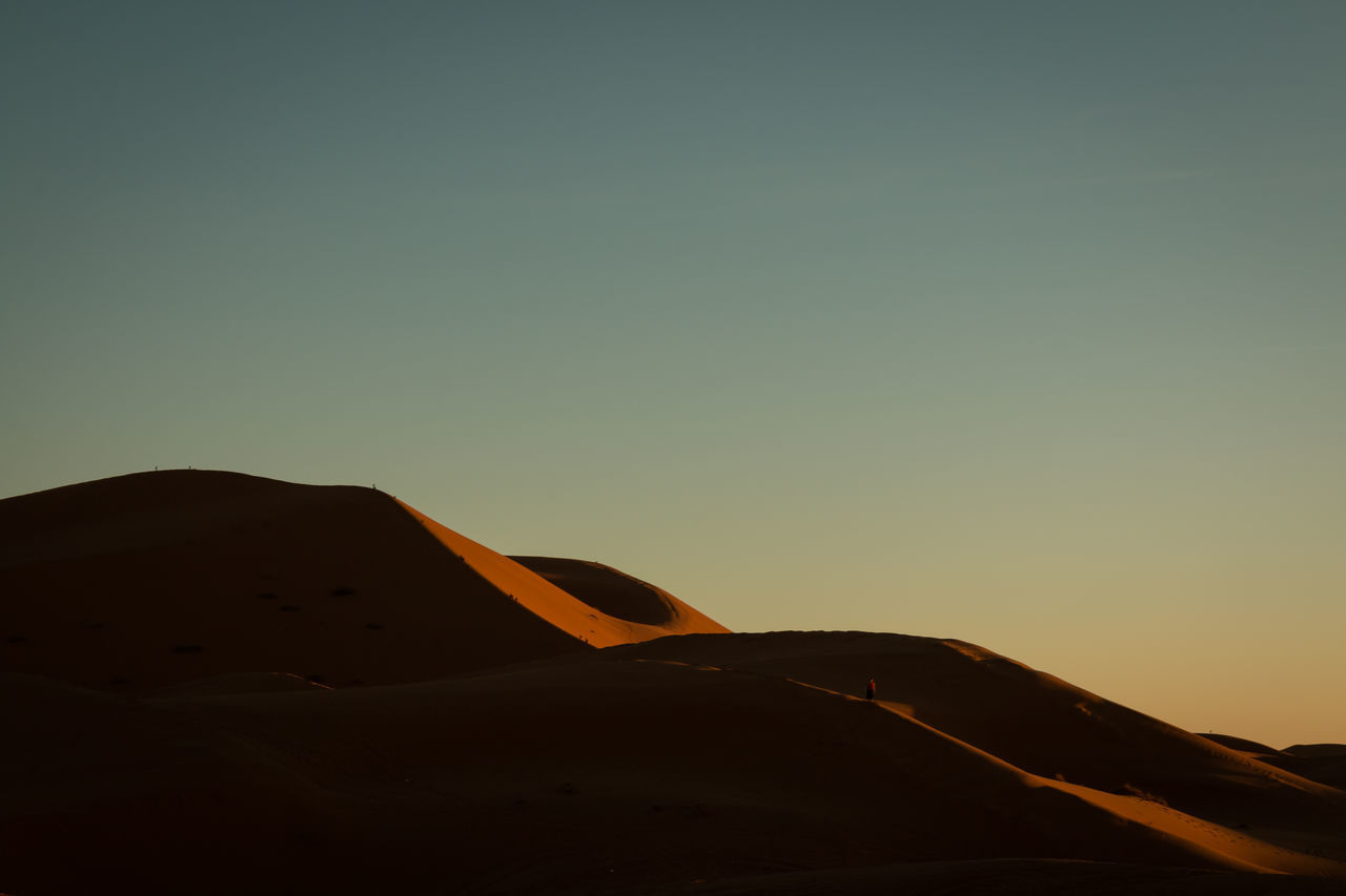 sky, copy space, clear sky, no people, desert, beauty in nature, scenics - nature, landscape, land, nature, tranquility, sunset, sand dune, tranquil scene, sand, environment, non-urban scene, travel, mode of transportation, outdoors, arid climate, climate