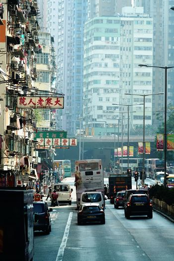 One Day cityscapes Street Photography Reframinghk Discoverhongkong City Car Mode Of Transportation Motor Vehicle Transportation Architecture Street Building Exterior Built Structure Land Vehicle City Life Incidental People Road City Street Taxi Traffic Building Travel Communication Sign
