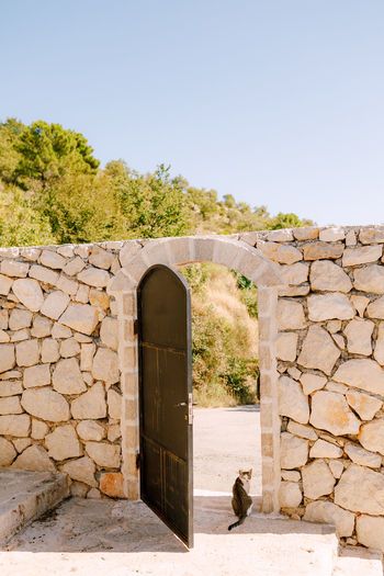 Stone wall against clear sky