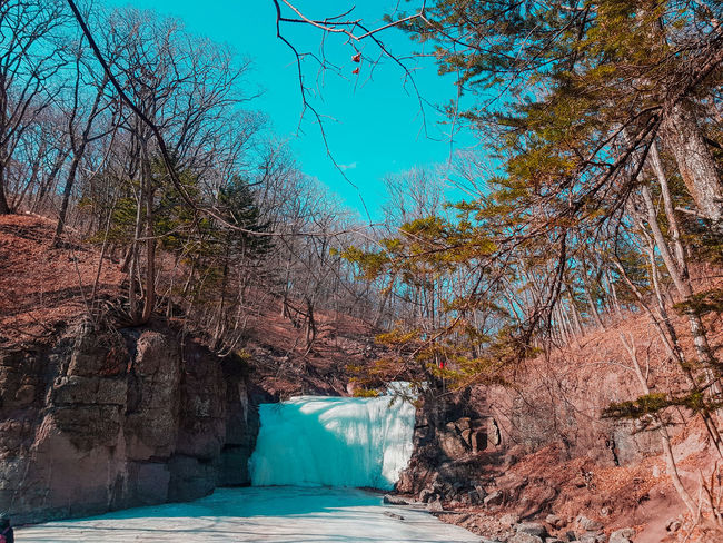 Explore Exploring Winter Trip Ice River Cold Temperature Waterfall Rock Water Swimming Pool Tree Nature Blue Outdoors Sea No People Beauty In Nature Day Sky Mountain EyeEmNewHere Go Higher