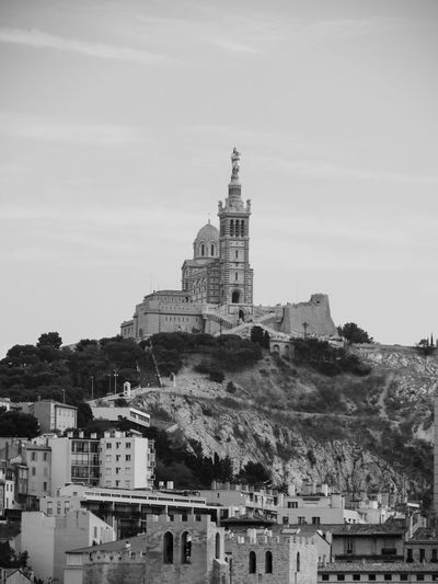 Kirche Kirchen Marseille Architecture Blackandwhite Photography Building Exterior Built Structure Churchesoftheworld Cities Of Europe City Day Frankeich History Mountain Nature No People Outdoors Place Of Worship Religion Schwarzweiß Sky Spirituality Travel Destinations Tree