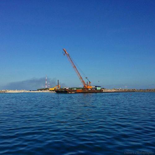 Crane - Construction Machinery Water Clear Sky Blue Sea Rippled Crane Scenics Development Tranquil Scene Tranquility Nature Day Outdoors Industry Harbor Commercial Dock No People Dino's Photography