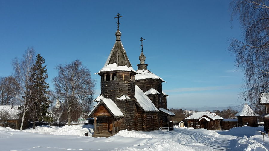 View of the wooden church in the open air museum of Suzdal', Russia Cold Temperature Built Structure Snow Architecture Winter Building Exterior Tree Sky Building Nature Place Of Worship Religion Plant Belief Spirituality Day No People Outdoors Spire  Open Air Museum Church Architecture Wooden Church  Landmark Building Russian Cultural Landscape