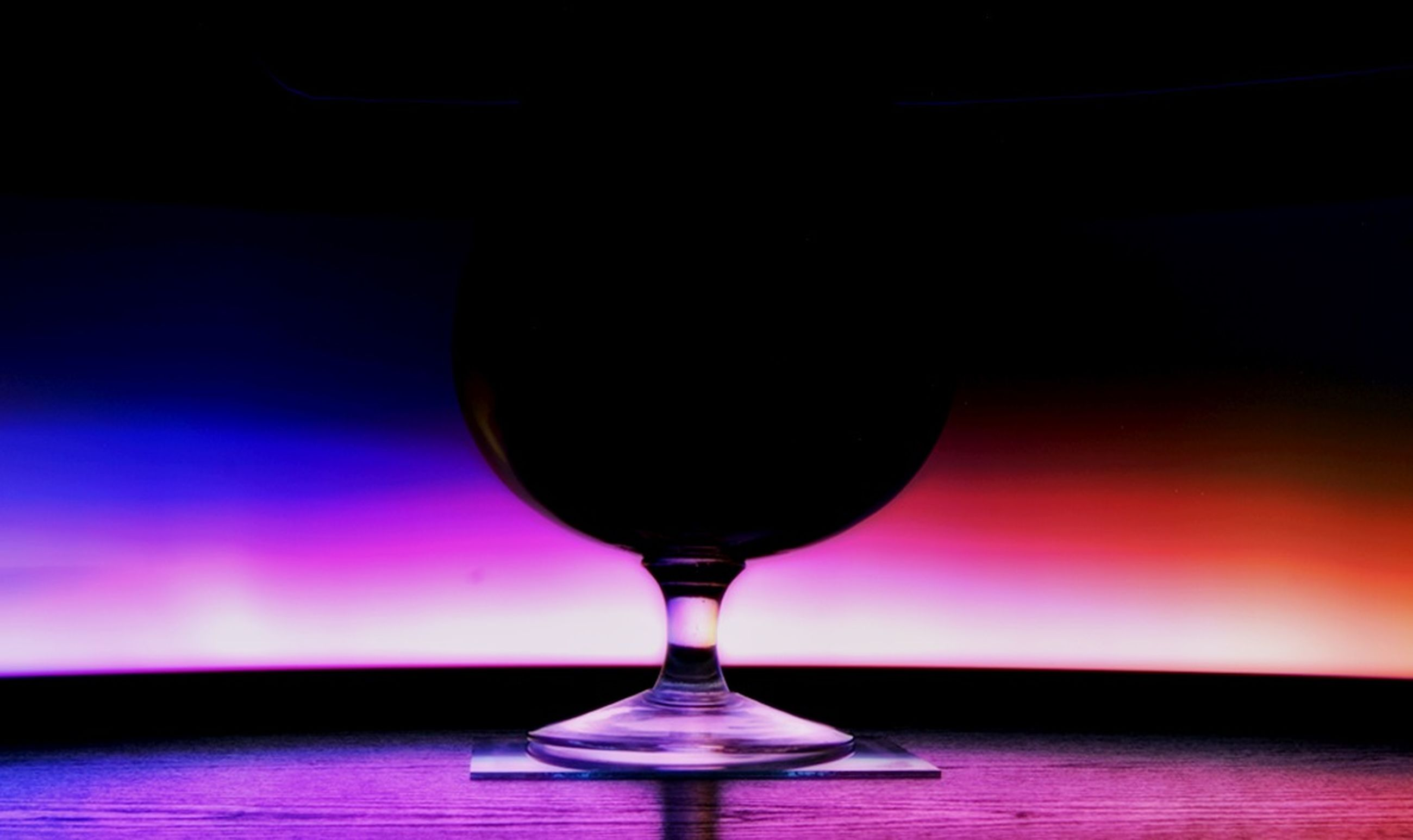 indoors, illuminated, table, still life, close-up, lighting equipment, wineglass, red, drink, drinking glass, refreshment, lit, food and drink, single object, alcohol, focus on foreground, no people, glass - material, wine, selective focus