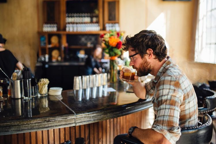 Man Having Cocktail In Bar