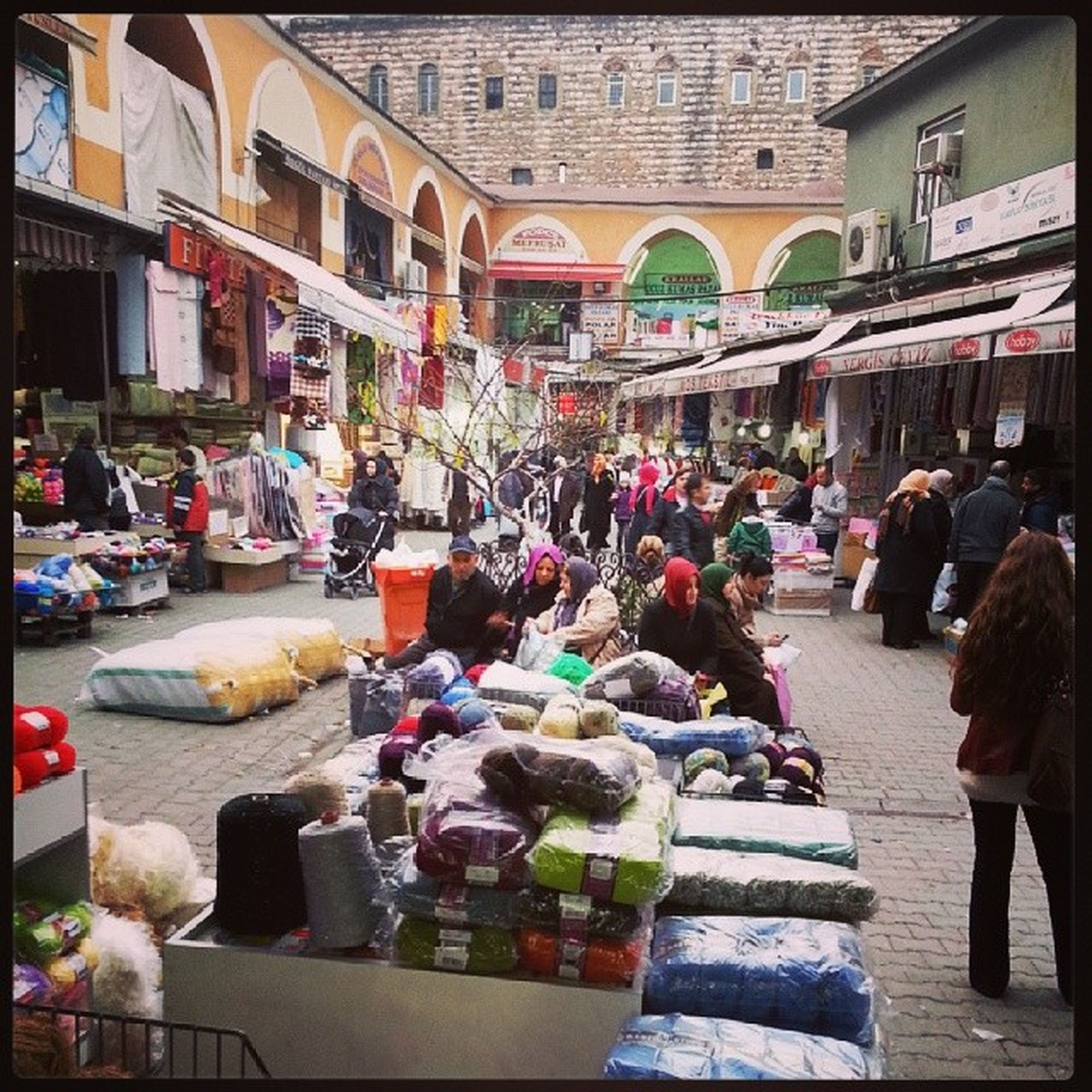 person, men, market, lifestyles, market stall, building exterior, architecture, built structure, retail, for sale, leisure activity, large group of objects, food and drink, incidental people, sitting, large group of people, variation, selling, choice