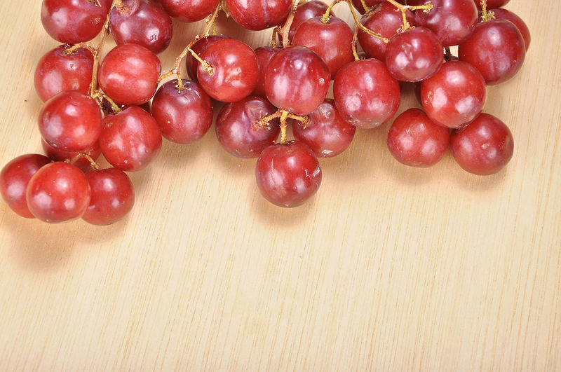 Close-up of red grapes on a table
