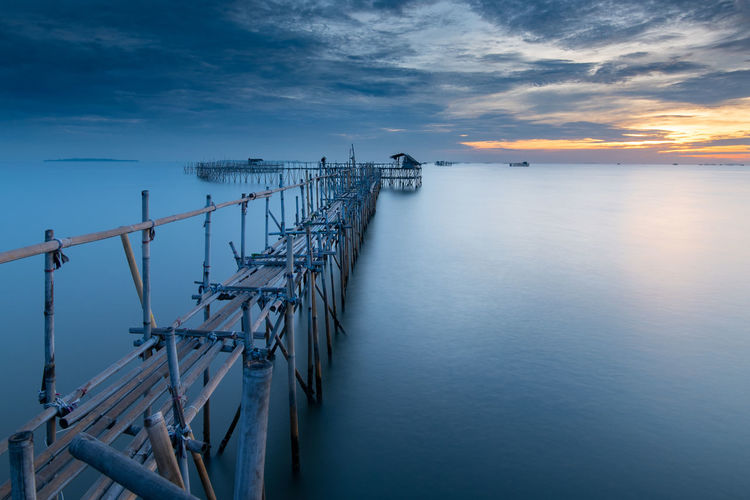 Traditional jetty used by local fisherman to reach the deeper part of the sea without boat Pier Soft Architecture Bamboo Beauty In Nature Built Structure Cloud - Sky Horizon Over Water Idyllic Jetty Long Exposure Nature Nautical Vessel No People Outdoors Railing Scenics - Nature Sea Sky Slowshutter Sunset Traditional Tranquil Scene Tranquility Water