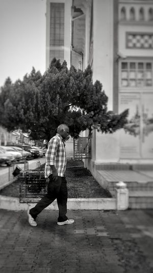 Walking alone at the street One Man Only Full Length Only Men One Person Adult Adults Only People City Outdoors Men Young Adult Day Real People Tree EyeEm Masterclass Vintage Photography Creative Light And Shadow EyeEmNewHere EyeEm Best Shots - Black + White EyeEmBestEdits EyeEm Best Edits Eyeemphotography EyeEmbestshots EyeEm Best Shots EyeEmBestPics