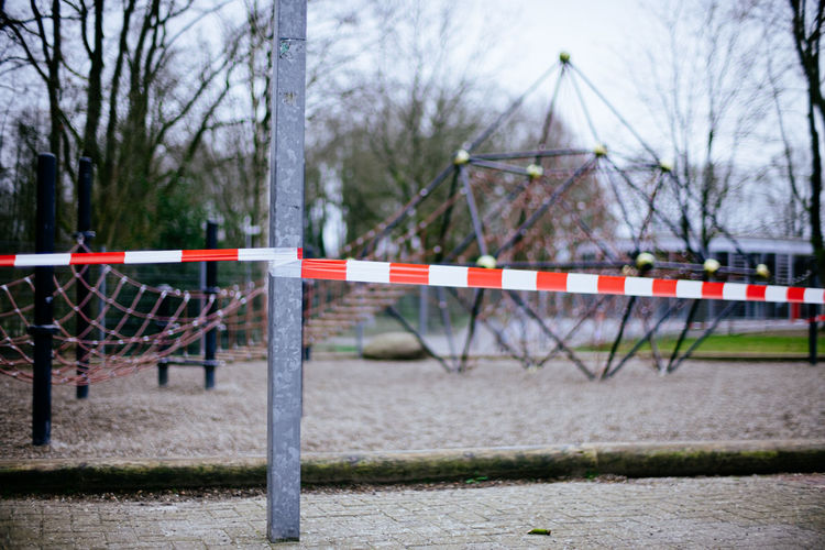 Cordon tape on pole at playground