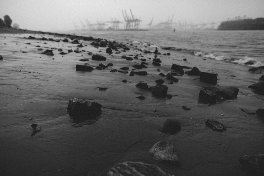 Beach Beauty In Nature Black And White Crane Day Ebb And Flow Elbstrand Grey Sky Hamburg Harbour Horizon Over Water Moody Nature No People Out Of Focus Outdoors Sand Scenics Sea Shore Sky Tideland Tranquil Scene Tranquility Water