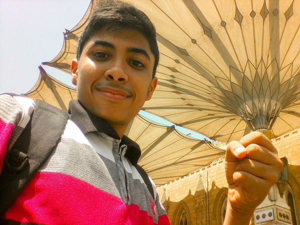 Young Man Out AL-Hussain Mosque EyeEmNewHere Young Big Umbrella Close-up Day Front View Looking At Camera Low Angle View One Person Optical Illusion Real People Young Men Done That.