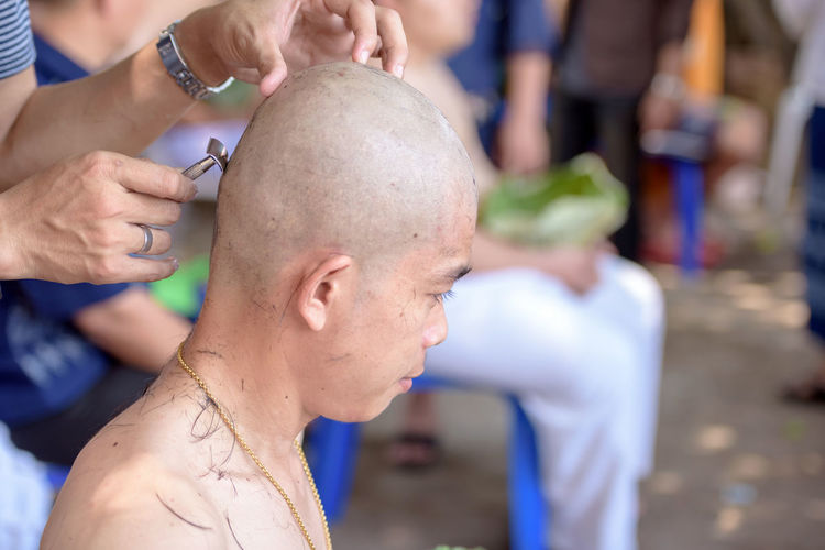 Thailand Culture with Hold lotus leaves for his hair while shaved head man for Buddha. Lifestyle Shaved Shaved Hair Shaved Head Tradition Traditional Culture Countryside Countryside Life Ordain Priest