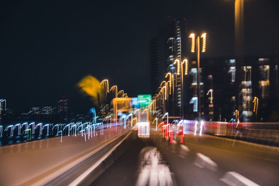 Glitch Showing Imperfection Highway Driving Around Night City Long Exposure Building Exterior Light Trail Architecture Blurred Motion Motion Transportation Road Speed Built Structure Outdoors City Life No People Cityscape High Street Enjoying Life Day EyeEm Gallery Light And Shadow
