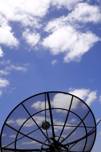 A television satellite receiver dish in use Communications Cloud - Sky Day Electronics  Low Angle View No People Outdoors Receiver Satellite Dish Sky Technology Television Receiver