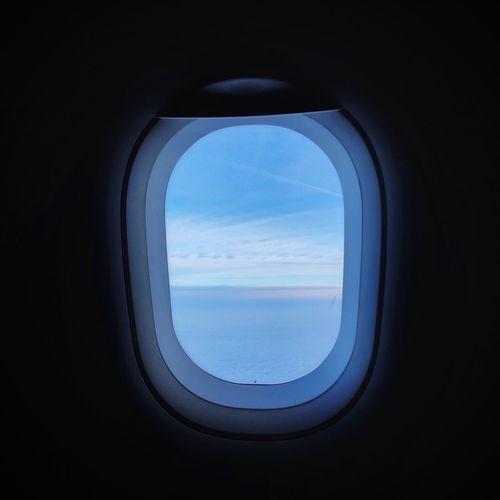 Sky seen through airplane window