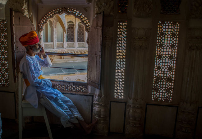 One Person Adult People Travel Destinations Individuality Full Length Indoors  Portrait Day Indian Culture  Indian Culture  Indian Culture  India Rajasthan Mehrangarhfort Mehrangarh Jodhpur Fort Jodhpur Rajasthan Jodhpur Fort Old Building  Old Buildings Indoors  Oldman Low Angle View TCPM Investing In Quality Of Life