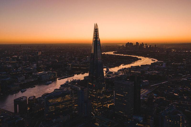 Shard london bridge amidst cityscape during sunset