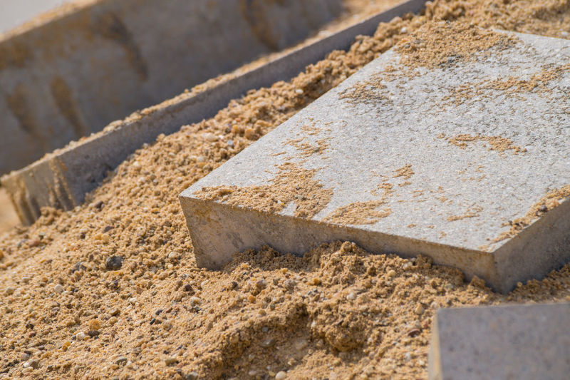 Close-up of concrete bricks on sand