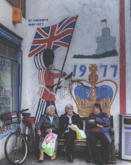 Having a chat Old Ladies United Kingdom Flag Soldier Bike Sitting Granny Up Close Street Photography Feel The Journey