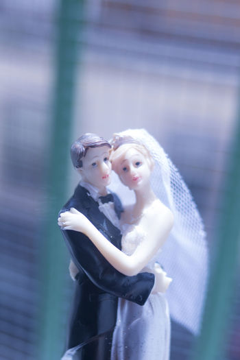Wedding Topper Bride Groom Couple Marriage  White Love Decoration Isolated Celebration Top Man Wife Background Figurines  Woman Figurine  Bridal Married Husband Cake Toppers Wed Ceremony Ornament Closeup Romance Happy Figure Traditional Dress Doll Beautiful Female Tuxedo Evening Suit Bridegroom Lover Romantic Veil Holding Bow Tie