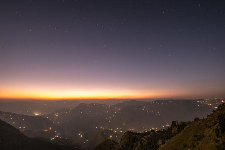 Lost In The Landscape The tiny houses at twilight in a vast valley. Night Astronomy Sky Space Landscape Mountain Nature Mountain Peak Mountain Range Sunset Vantage Point Nature Photography Mountains Non-urban Scene Road Less Travelled Nikon D750 Getty Images Nikon India Himalayas Himachalpradesh Natgeotravellerindia Travel Photography Lonelyplanet