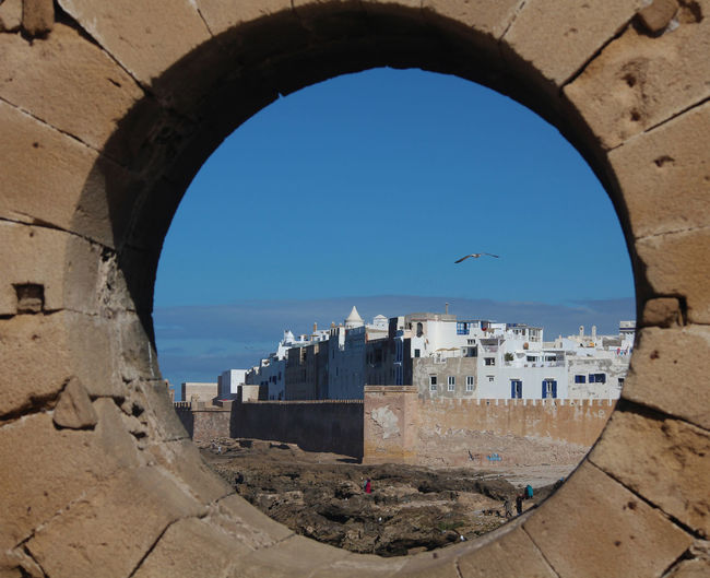 Framed View Game Of Thrones Arch Architecture Bird Blue Brick Frame Building Exterior Built Structure Clear Sky Day Essouira Horizon Over Water Natural Frame Nature No People Outdoors Round Window Sea Sky Sunlight Water