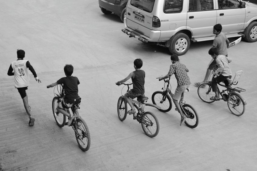 Life's just a bicycle ride said no one ever. Kids during summer usually go for a bicycle ride rather than just playing games. This gives them the oppurtunity to discover the rarest of places in and around the city. The level of curiosity children have cannot match the adults or even cats 😜. Summer is all about this.EyeEm Diversity Bicycle Cycling Sport Day Outdoors Children Kids Playing Kids Riding Bikes Happy Times Fresh On Eyeem  Break The Mold BYOPaper! The Street Photographer - 2017 EyeEm Awards Live For The Story The Week On EyeEm