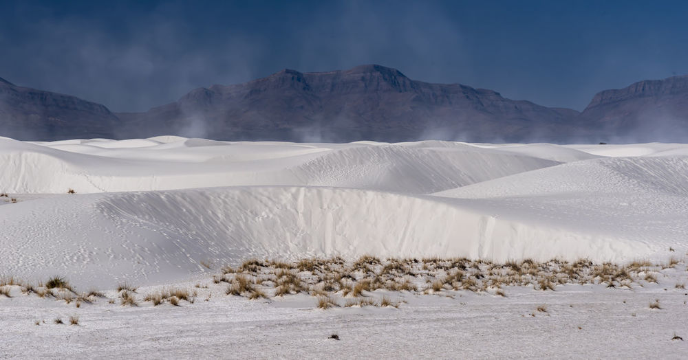 Scenic view of sand mountains against sky