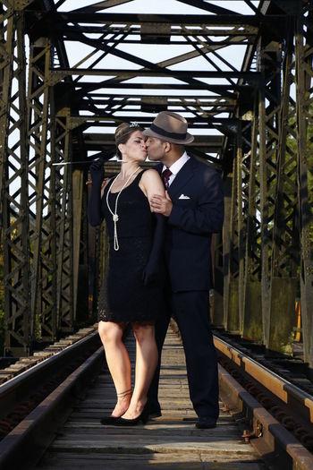 Full length of man standing on railroad tracks