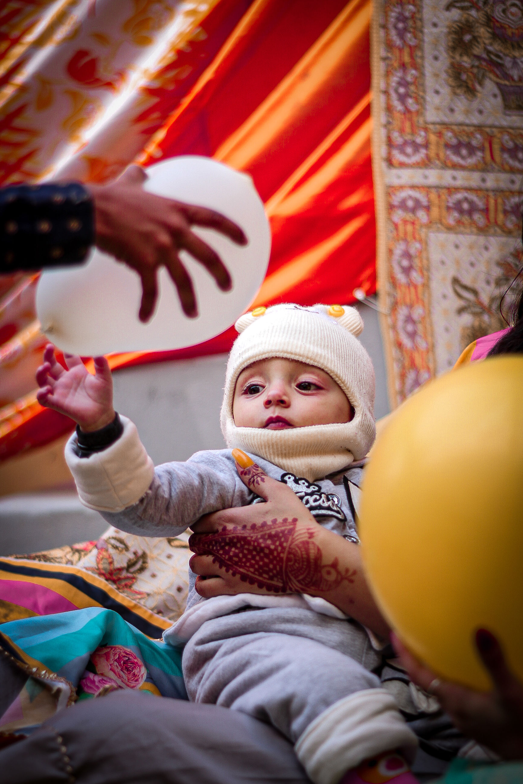 child, childhood, baby, happiness, hat, clothing, smiling, emotion, toddler, men, adult, sitting, two people, celebration, women, female, family, fun, togetherness, holding, indoors, cute, positive emotion, enjoyment, cheerful, portrait, lifestyles, person, holiday, innocence, selective focus, parent, event