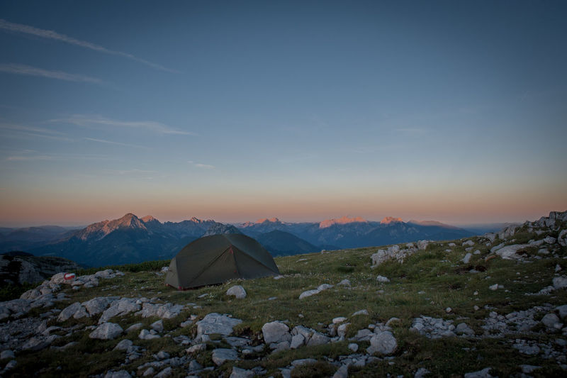 A night outside in the mountains Mountain Sky Scenics - Nature Beauty In Nature Tranquil Scene Tranquility Snow Environment Landscape Tent Winter Cold Temperature Nature No People Non-urban Scene Remote Idyllic Sunset Camping Mountain Range Outdoors Snowcapped Mountain Mountain Peak