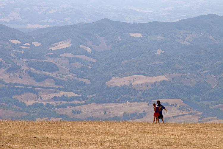 Children playing on a hillside in Umbria, Italy Children Copy Space EyeEmNewHere Beauty In Nature Day Environment Full Length Land Landscape Leisure Activity Lifestyles Men Mountain Mountain Range Nature Non-urban Scene One Person Outdoors Real People Scenics - Nature Tranquil Scene Tranquility Wallpaper