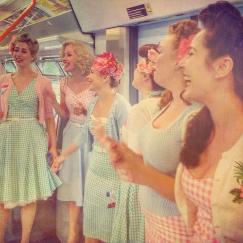 Women Around The World Singing on a Train: The Tootsie Rollers London Tootsie Rollers Standing Women Singers Singing On A Train Enjoyment Group Of People