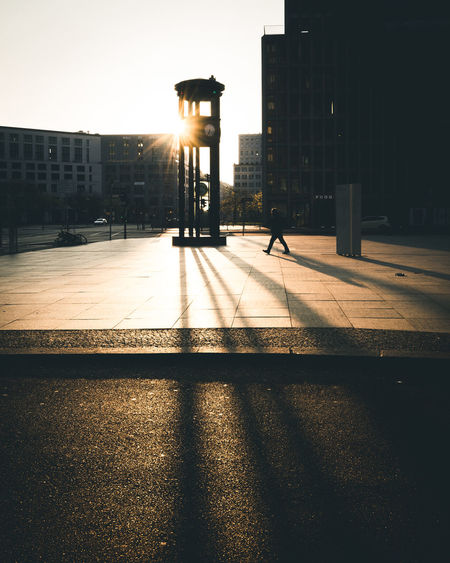 Deep Sun on Potsdamer Platz Berlin Architecture Berlin Built Structure City Day Illuminated Morning One Person Outdoors Shadow Silhouette Sunlight The Week Of Eyeem Walking The Street Photographer - 2017 EyeEm Awards