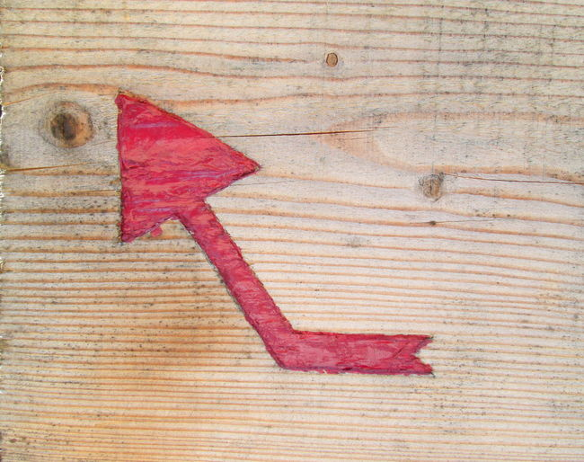 Single red arrow painted on wooden board Arrow Backgrounds Close-up Creativity Detail Full Frame Geometry Guidance Ideas Old-fashioned Painted Part Of Pattern Red Scratched And Cracked Wood Still Life Symbol Textured  Timber Up Wood Wood - Material Wooden Textures And Surfaces ArchiTexture