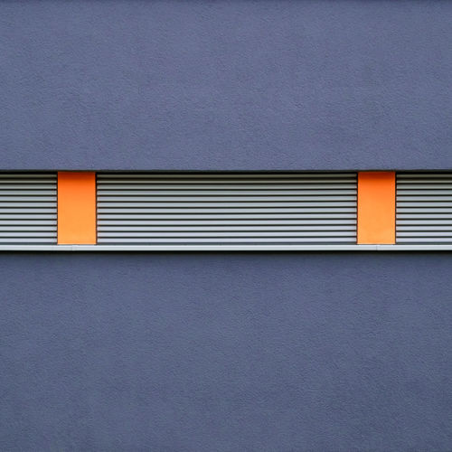 Architecture Built Structure Building Exterior Gray No People Wall - Building Feature Day Pattern Yellow Close-up Building Textured  Orange Color Window Copy Space Full Frame Outdoors Backgrounds Blue Closed Purple