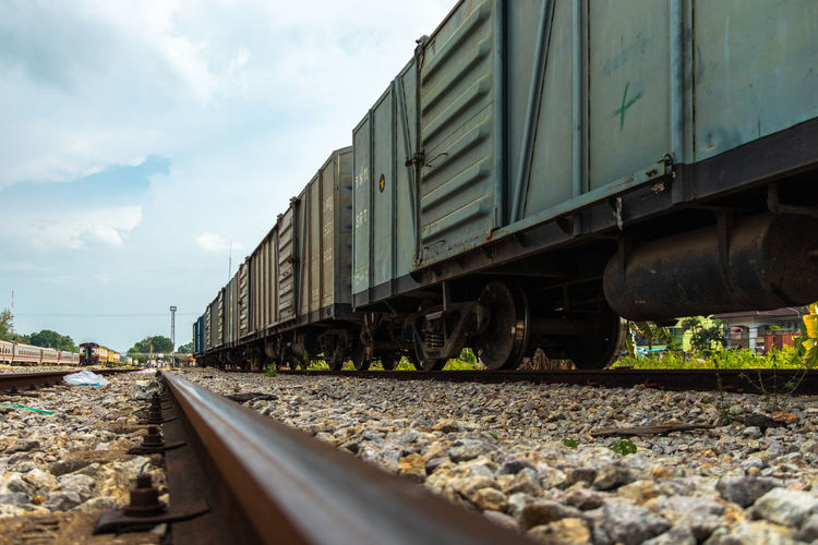 View Of Train On Railroad Track Against Sky