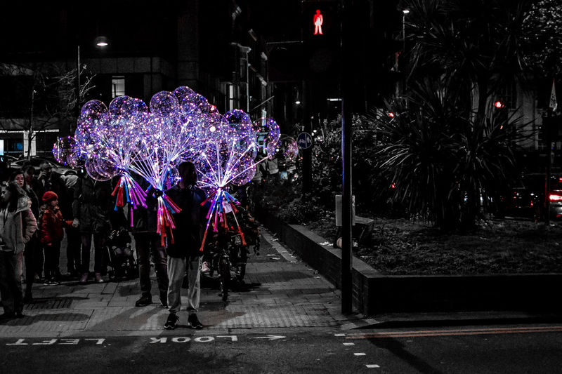 Soul Catcher -- Balloon seller in London during New Year's Eve Night Illuminated Real People City Street Plant Celebration Group Of People Lifestyles Nature Tree Architecture Decoration Women Men Outdoors Leisure Activity Incidental People Built Structure People Purple Soul Balloon London
