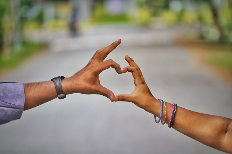 Cropped Image Of Hands Forming A Heart